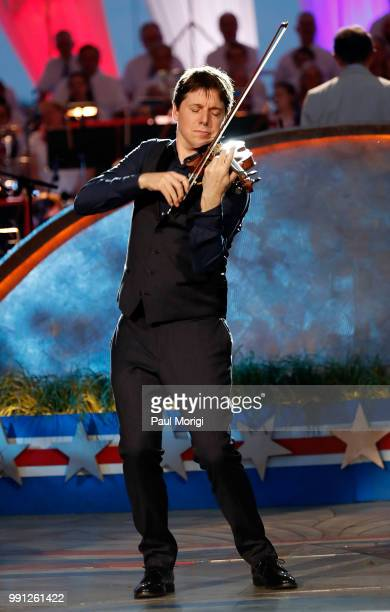 Internationally acclaimed Grammy Awardwinning violinist Joshua Bell with the National Symphony Orchestra under the direction of top pops conductor...