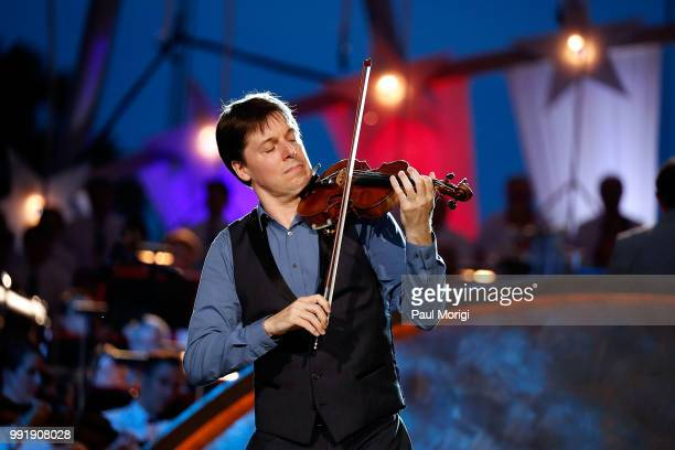 Internationally acclaimed Grammy Awardwinning violinist Joshua Bell performs at the 2018 A Capitol Fourth at the US Capitol West Lawn on July 4 2018...