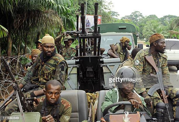 Internationally recognised leader Alassane Ouattara's FRCI soldiers ride an armed vehicle as they prepare for the socalled ''final assault'' in front...
