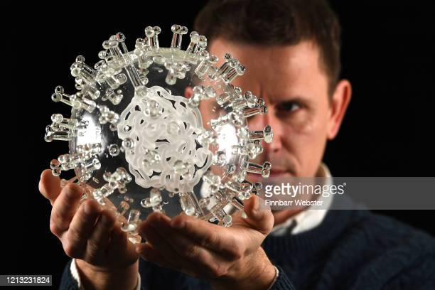 Internationallyrenowned artist Luke Jerram with his coronavirus COVID19 glass sculpture on March 18 2020 in Bristol United Kingdom Made in glass at...