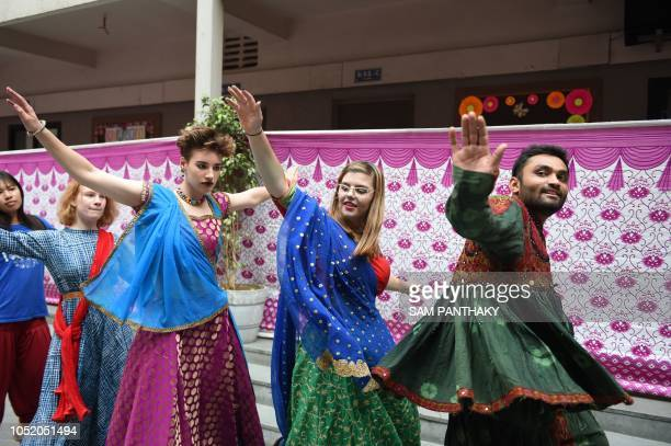 Internationals students take part in dance lessons from their Indian counterparts as they practice the 'Garba For Global Peace' in Ahmedabad on...
