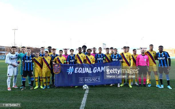Internazionale and FC Barcelona teams line up before the UEFA Youth League group F match between FC Internazionale and FC Barcelona at Stadio Breda...