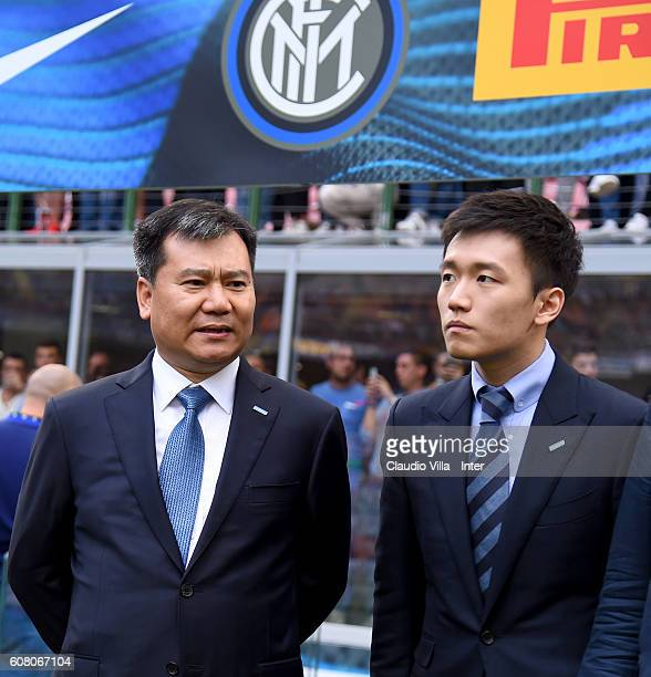 Internazionale board member Steven Zhang and chairman of Suning holdings group Zhang Jindong chat prior to the Serie A match between FC...