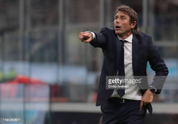 Internazionale coach Antonio Conte issues instructions to his players during the Serie A match between FC Internazionale and US Lecce at Stadio...