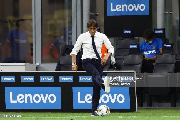 Internazionale coach Antonio Conte kicks a ball during the Serie A match between FC Internazionale and ACF Fiorentina at Stadio Giuseppe Meazza on...