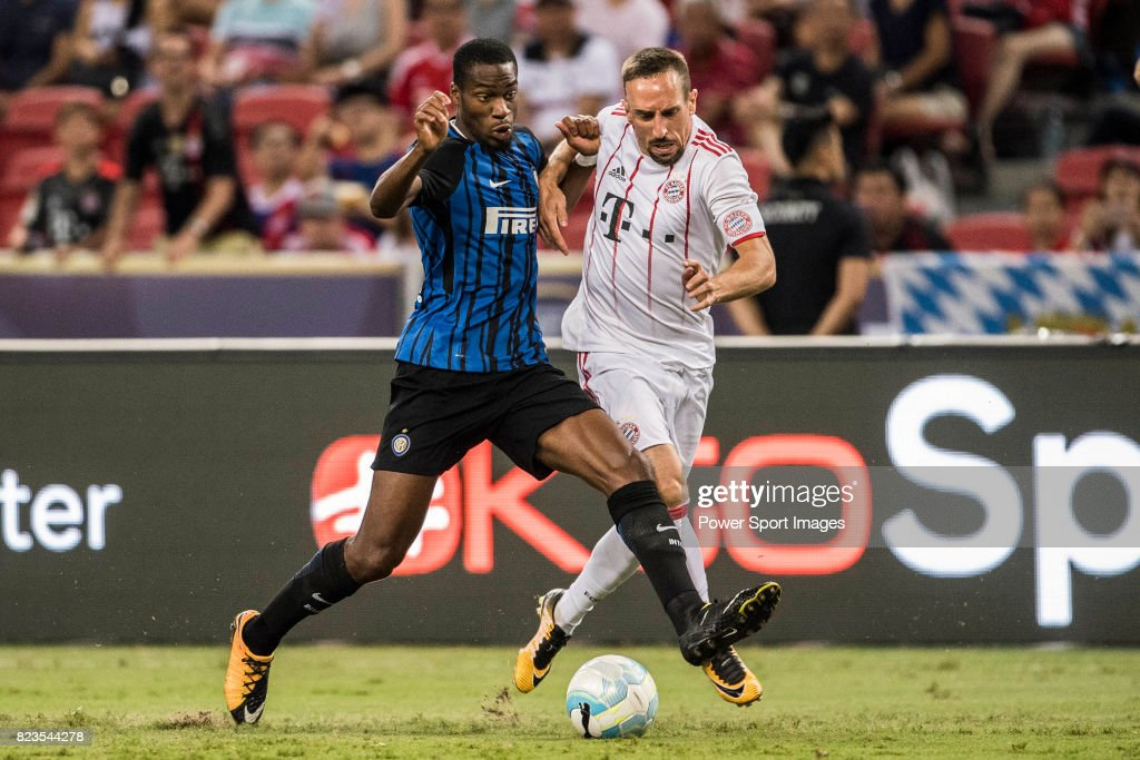 FC Internazionale Midfielder Geoffrey Kondogbia (L) fights for the ball with Bayern Munich Midfielder Franck Ribery (R) during the International Champions Cup match between FC Bayern and FC Internazionale at National Stadium on July 27, 2017 in Singapore.