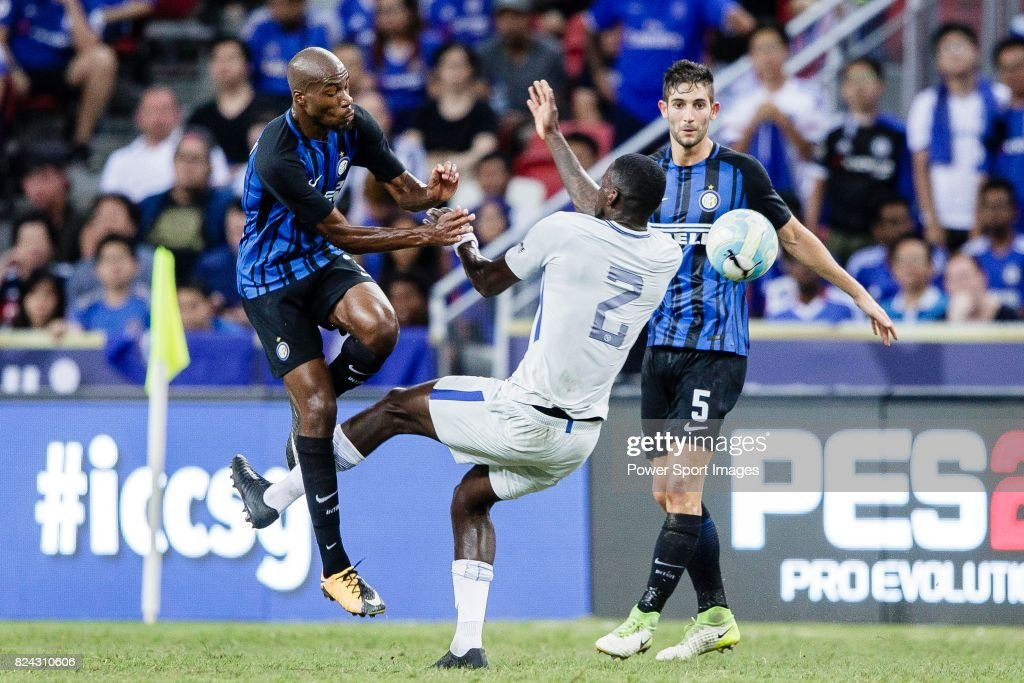 FC Internazionale Midfielder Geoffrey Kondogbia (L) fights for the ball with Chelsea Defender Antonio Rudiger (R) during the International Champions Cup 2017 match between FC Internazionale and Chelsea FC on July 29, 2017 in Singapore.