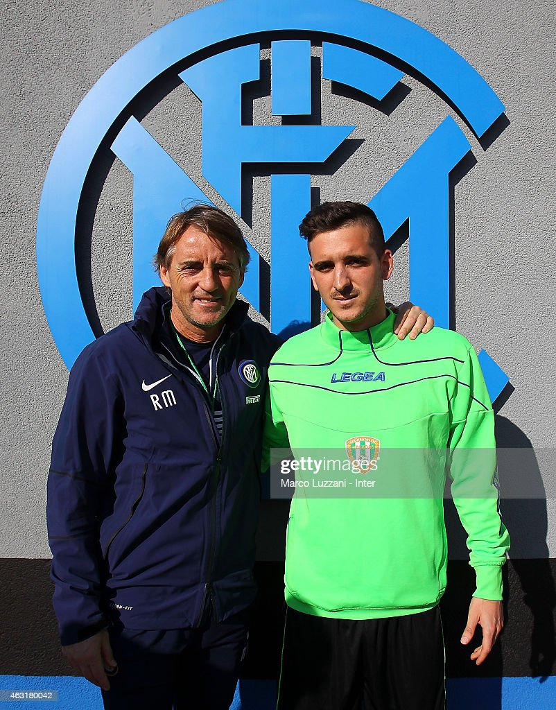 FC Internazionale Milano coach Roberto Mancini and Andrea Mancini before FC Internazionale training session at the club's training ground on February 11, 2015 in Como, Italy.