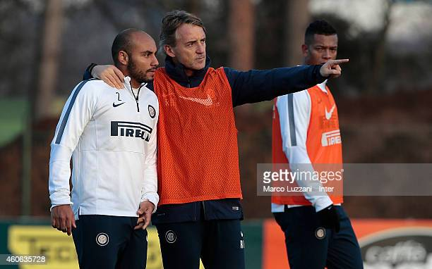 Internazionale Milano coach Roberto Mancini issues instructions to his player Cicero Moreira Jonathan during FC Internazionale training session at...
