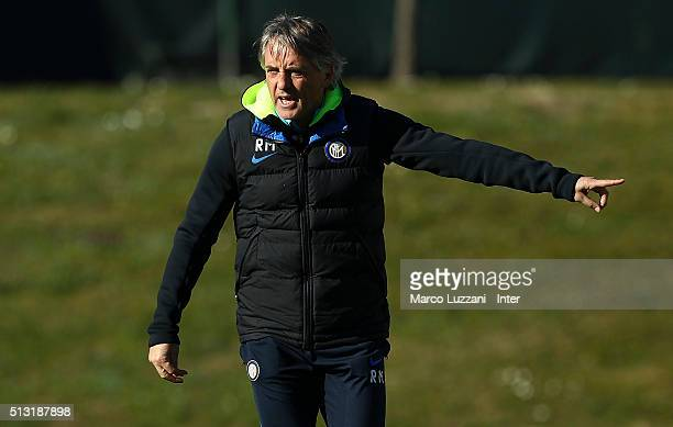Internazionale Milano coach Roberto Mancini issues instructions to his players during the FC Internazionale training session at the club's training...