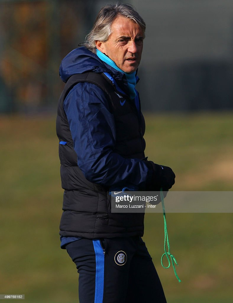 FC Internazionale Milano coach Roberto Mancini looks on during the FC Internazionale training session at the club's training ground on December 3, 2015 in Appiano Gentile Como, Italy.