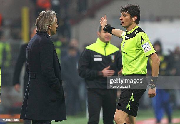 Internazionale Milano coach Roberto Mancini receives the red card from referee Antonio Damato during the Serie A match between AC Milan and FC...