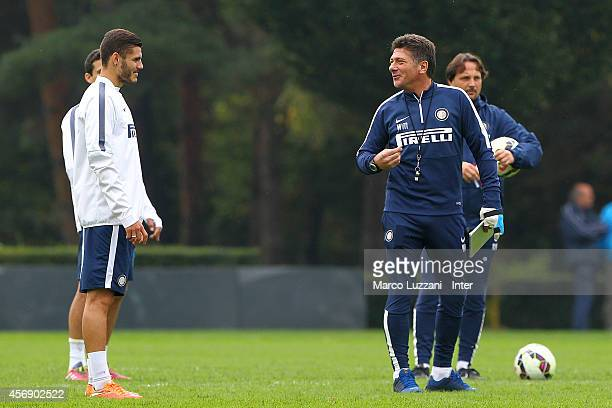 Internazionale Milano coach Walter Mazzarri speaks to Mauro Emanuel Icardi during FC Internazionale training session at the club's training ground on...