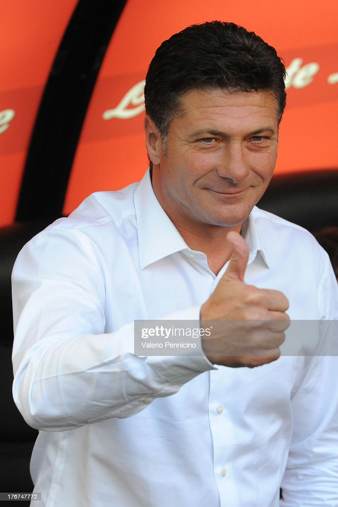 FC Internazionale Milano head coach Walter Mazzarri gestures prior to the TIM cup match between FC Internazionale Milano and AS Cittadella at Stadio Giuseppe Meazza on August 18, 2013 in Milan, Italy.