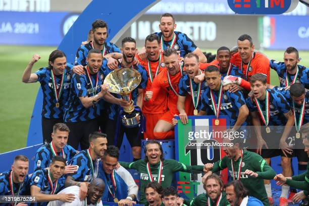 Internazionale Milano players and staff celebrate with the Scudetto trophy following the Serie A match between FC Internazionale Milano and Udinese...