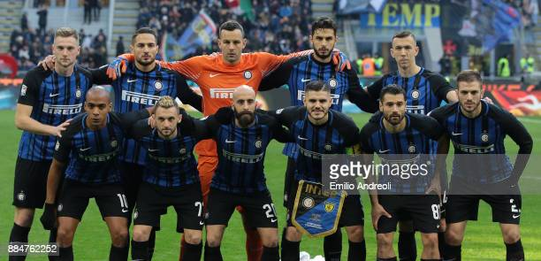 Internazionale Milano team line up before the Serie A match between FC Internazionale and AC Chievo Verona at Stadio Giuseppe Meazza on December 3...
