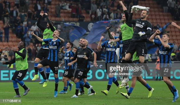 Internazionale players celebrate the victory at the end of the Serie A match between FC Internazionale and SS Lazio at Stadio Giuseppe Meazza on...
