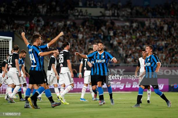 Internazionale players celebrate their first goal scored by Matthijs de Ligt of Juventus during the International Champions Cup match between...