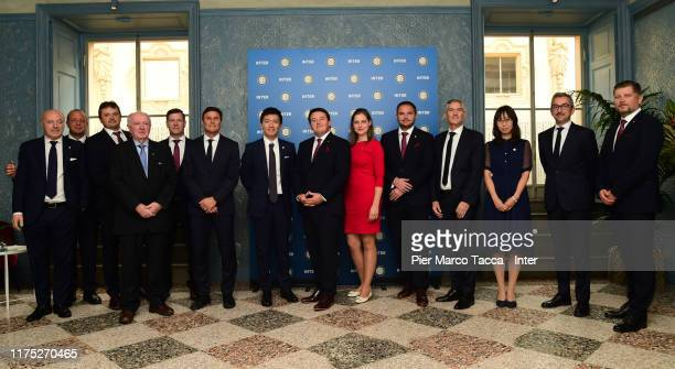 Internazionale President Steven Zhang and Slavia Praha Vice Chairman Tomáš Syrovátka pose for a picture with delegations members during the...