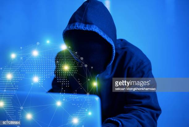 internet crime concept. hacker working on a code on dark digital background with digital interface around. - scammer stock pictures, royalty-free photos & images