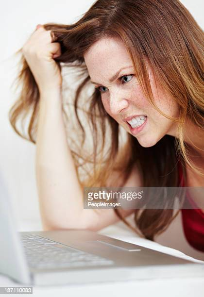 internet frustration - pulling hair stock photos and pictures