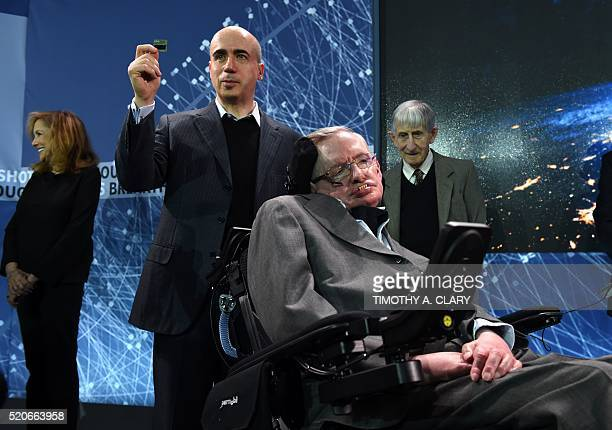 Internet investor and science philanthropist Yuri Milner holds up a StarChip with renowned cosmologist Professor Stephen Hawking during a press...