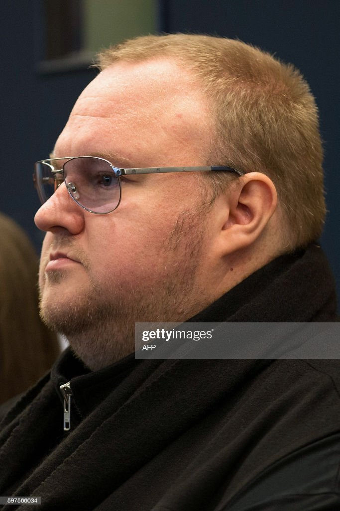Internet mogul Kim Dotcom attends his extradition appeal at the High Court in Auckland on August 29, 2016. Internet mogul Kim Dotcom launched his appeal against extradition from New Zealand to the United States on August 29 arguing for his case to be live-streamed to ensure a fair hearing. / AFP / POOL / Dave Rowland