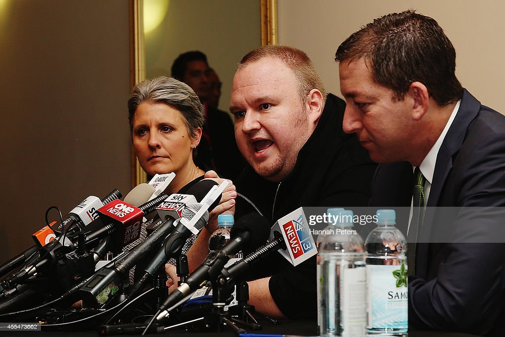 Internet Party leader Laila Harre, Kim Dotcom and Glenn Greenwald speak to the media following revelations about New Zealand's mass surveillance at Auckland Town Hall on September 15, 2014 in Auckland, New Zealand. The general election in New Zealand will be held this weekend, on 20 September 2014.