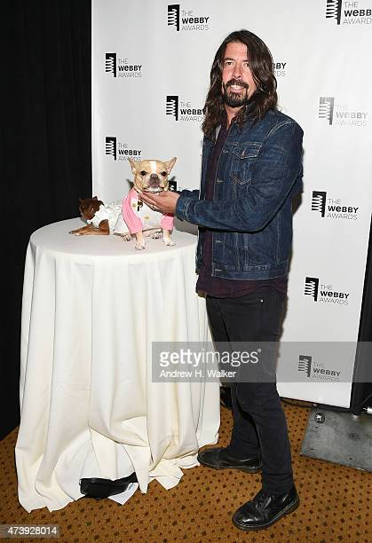 Internet personalities Chloe Kardoggian Chloe the Mini Frenchie and musician Dave Grohl attend the 19th Annual Webby Awards on May 18 2015 in New...