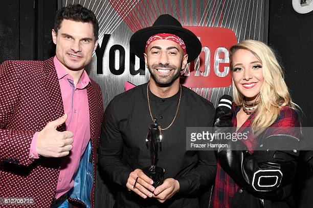 Internet personalities Flula Borg Yousef Erakat and Jenna Marbles pose with the Entertainer of the Year award during the 6th annual Streamy Awards...