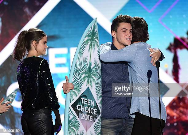 Internet personalities Grayson Dolan and Ethan Dolan accept the Choice Web Stars award from actresss Maia Mitchell onstage during Teen Choice Awards...