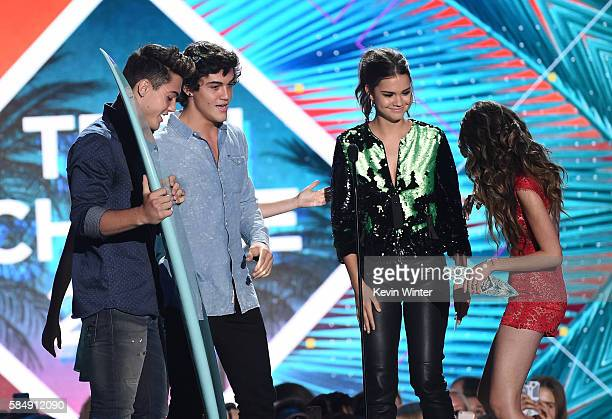 Internet personalities Grayson Dolan and Ethan Dolan accept the Choice Web Stars award from actors Maia Mitchell and Laura Marano onstage during Teen...