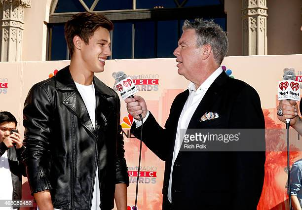 Internet personality Cameron Dallas and radio personality Elvis Duran attend the 2015 iHeartRadio Music Awards which broadcasted live on NBC from The...