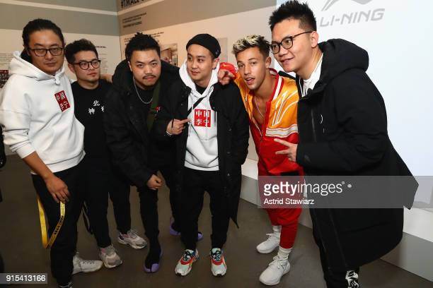Internet personality Cameron Dallas poses with the LiNing fashion designers attends the LiNing Fall/Winter 2018 Collection Fashion Show during 2018...