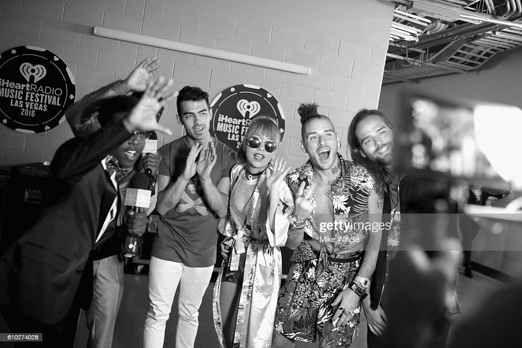 Internet personality Jeremiah Hall and recording artists Joe Jonas, JinJoo Lee, Cole Whittle, and Jack Lawless of music group DNCE attend the 2016 iHeartRadio Music Festival at T-Mobile Arena on September 24, 2016 in Las Vegas, Nevada.