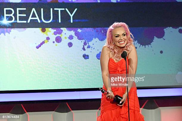 Internet personality Kandee Johnson accepts the Beauty award onstage during the 6th annual Streamy Awards hosted by King Bach and live streamed on...