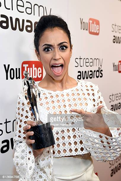 Internet personality Liza Koshy poses with the Breakout Creator award during the 6th annual Streamy Awards hosted by King Bach and live streamed on...
