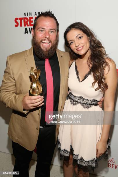 Internet personality Shay Carl recipient of the Icon Award and internet personality Bethany Mota winner of Best Fashion Program attend the 4th Annual...