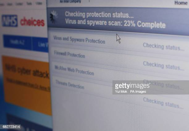 Internet security software performing an antivirus and antispyware scan on a laptop after the NHS has been hit by a major cyber attack on its...