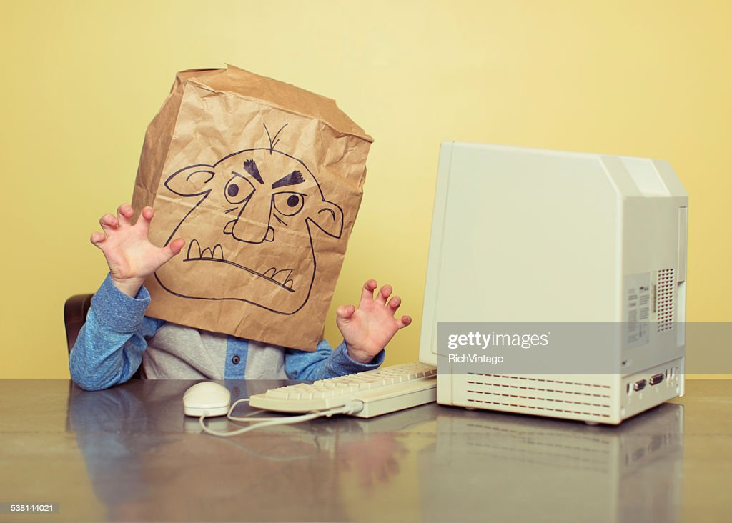 Internet Troll is Mean at the Computer : Stock Photo