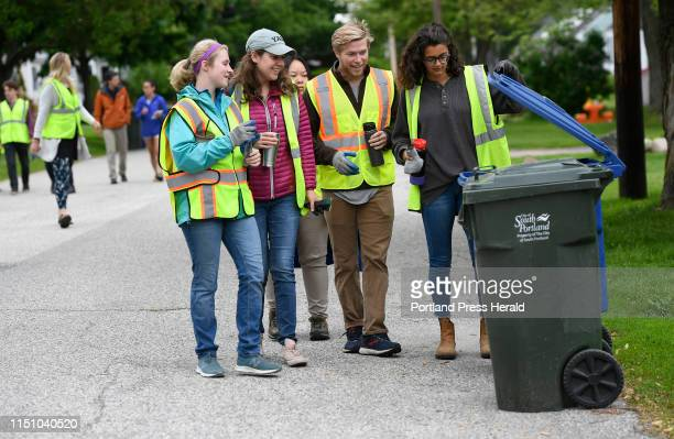 Interns peek into a recycling container in South Portland Thursday June 13 2019 L to R are Abby Constantine Lexis Anderson Julie Gourlay in the...