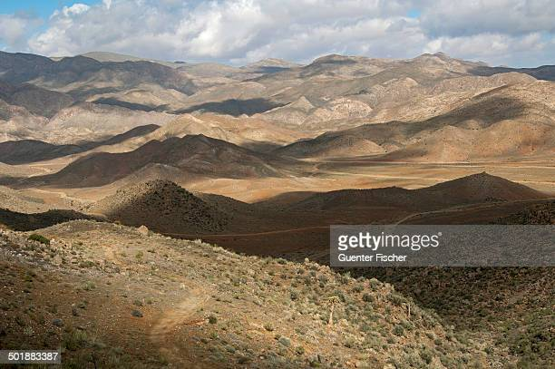 Interplay of light and shadow on a hilly landscape, Richtersveld, Richtersveld Nationalpark, Northern Cape, South Africa