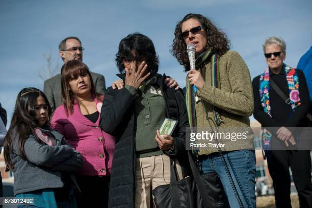 Interpreter Gabriela Flora speaks to the crowd after Jeanette Vizguerra returned from meeting with immigration authorities Vizguerra's stay of...