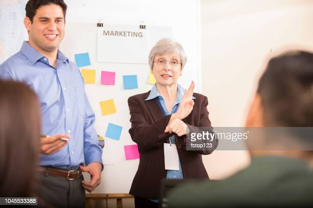 interpreter signing during business meeting. - translation stock pictures, royalty-free photos & images
