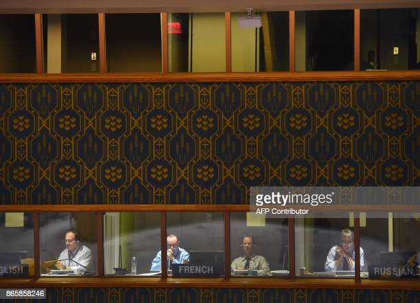 UN interpreters are seen during The UN Security Council votes to extend investigations into who is responsible for chemical weapons attacks in Syria...