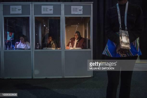Interpreters translate address from speakers on the first day of the 10th BRICS summit at Sandton Convention Center, in Sandton district of...