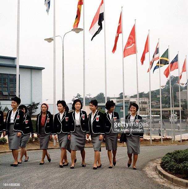 Interpreters walk in the Athletes Village ahead of Tokyo Olympic on September 15 1964 in Tokyo Japan