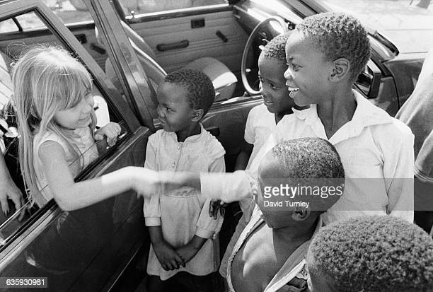 Interracial Children Shaking Hands