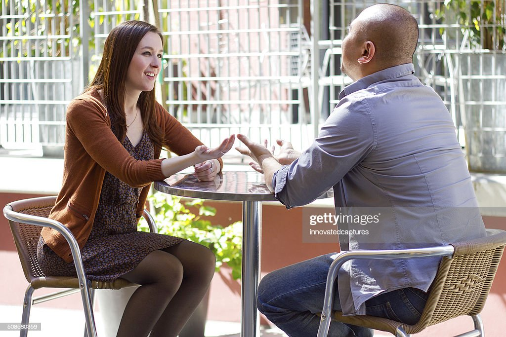 Interracial Couple on a First Date Outdoors : Stock Photo