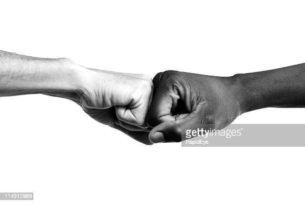 Interracial fists collide